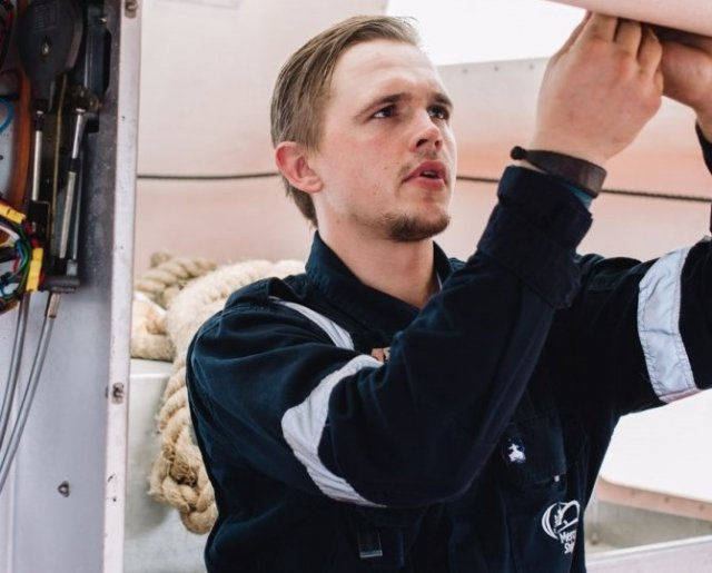 Filips Jansons, Electronics Technician, working on one of the lifeboats.