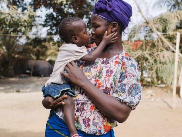 Aicha, eyes patient, with her mother at home after her surgery.