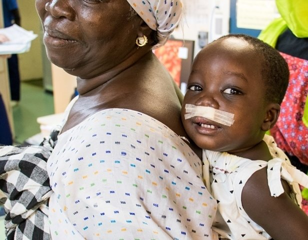 Saliou with his grandmother on D Ward.